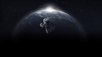 Астронавт в открытом космосе на фоне планеты земля